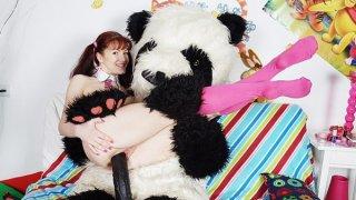 Sexy girl fucks with nasty panda bear