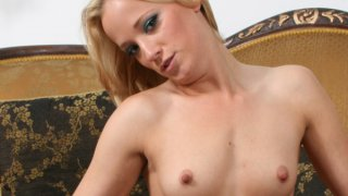 Blonde with small tits is drilling holes with glass dildo