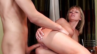 Blonde climbs the table for hard anal fuck