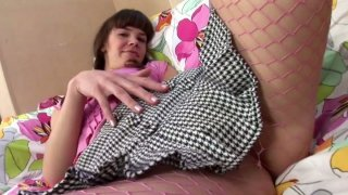 Sonia in pink net stockings masturbates her pussy