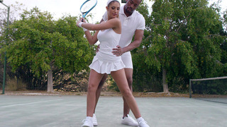 Busty August Ames flirting with her tennis couch