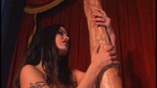 Gigantic two foot long dildo destroys hot brunette's pussy