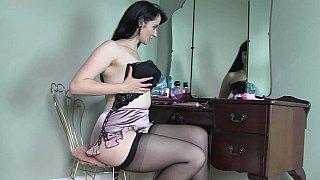 Natural girl taking her lingerie off