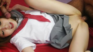 Ai in a schoolgirl uniform spreads her pussy for a hard dick