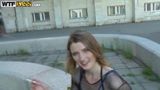 Slutty blonde having a dirty talk in the street
