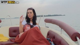 Buxom seductive and hot brunette gets cunnilingus on the yacht