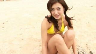 Bootylicious Asian whore Haruka Ogura poses in her yellow bikini