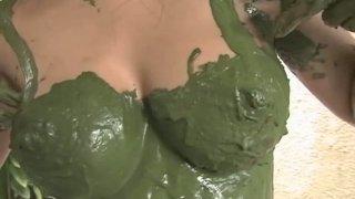 Narrow eyed goddess Arisa Oda covers her body with green matter