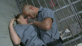 Busty blond cop sucks a cock right in the prison